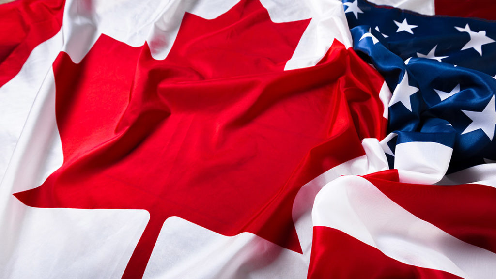American and Canadian Flag intertwined