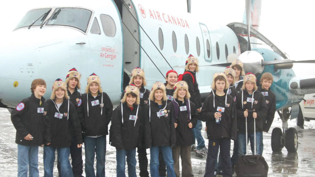 Young Hockey Players in front of Air Canada Plane